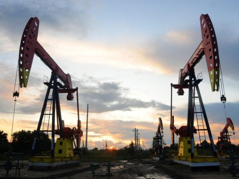 Oil edges lower after jump in US stockpiles, vaccine hopes capping losses